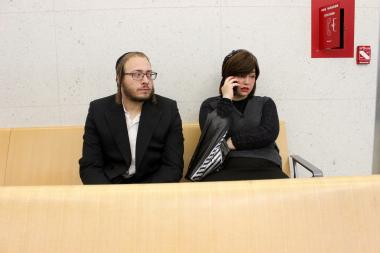 Mayer Herskovic, 24, and his wife who declined to give her name, waited for the man's trial to begin Monday morning.