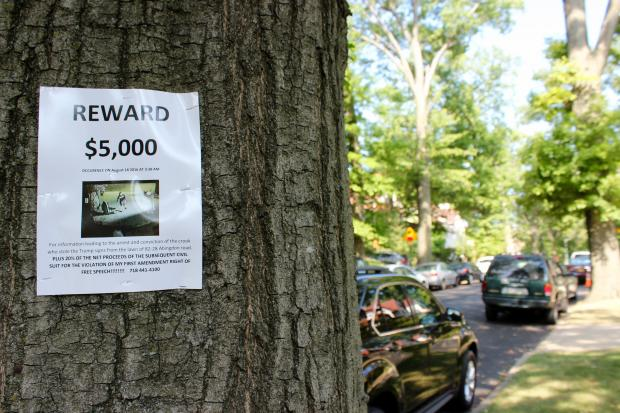 In August, Michael Ricatto placed dozens of fliers about Trump signs stolen from his property around Kew Gardens.