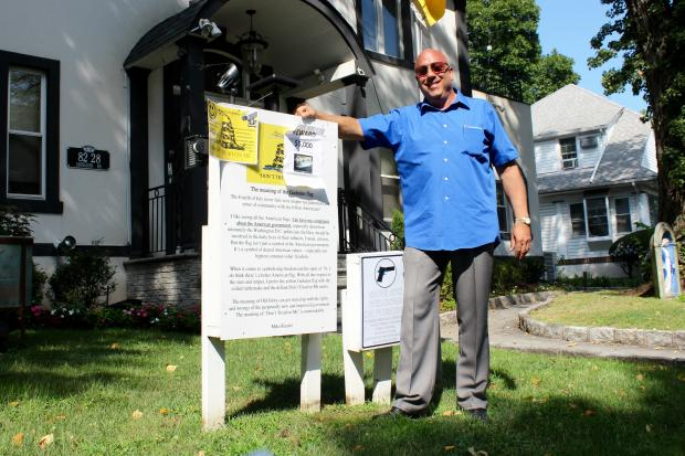 Michael Ricatto said Trump signs have been stolen from his lawn four times.
