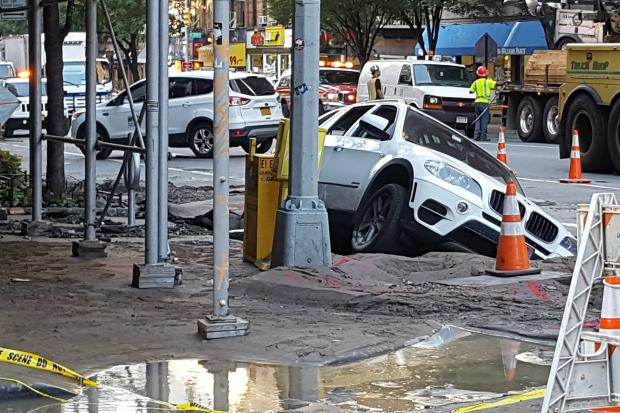 An SUV fell into a sinkhole after a water main break on the Upper West Side Monday night.