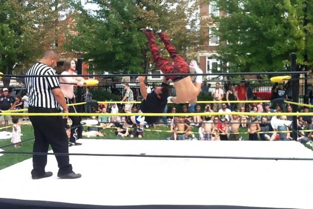 Lucha libre wrestlers compete in Unity Park last summer.