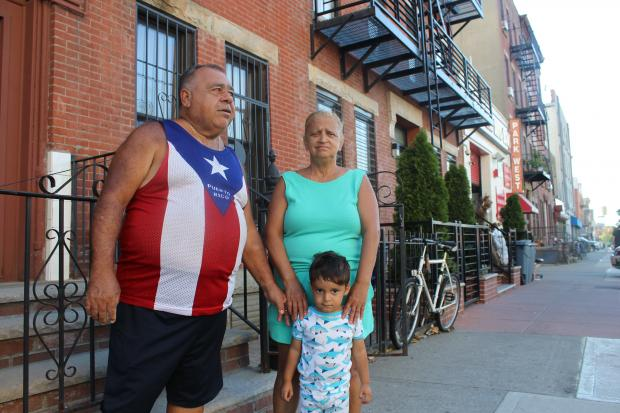 Gilberto Bravo and Nancy Luzunari (with their grandson) have lived on Union Street off Third Avenue in Gowanus for 26 years. Their block was once full of Puerto Rican families, but now there are just a few.