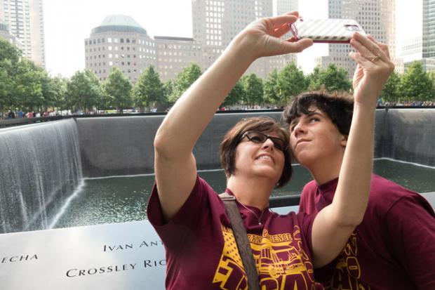 Visitors take a selfie at the 9/11 Memorial - a photo that's part of artist Bob Leonard's Memorialized exhibit.