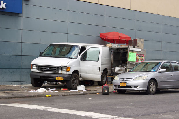 An elderly woman died after van ran her over and hit a 70-year-old food cart vendor, police said.