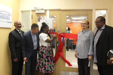Howard Brown Health opened a new location in Englewood. Dr. Maya Green cuts the ribbon while CEO David Ernesto Munar (left) watches with WVON's Cliff Kelley and Rev. Corey Brooks of New Beginnings Church.