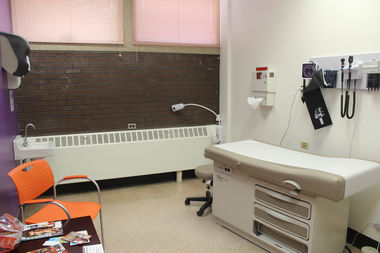 The new clinic has five exam rooms.