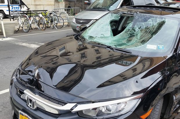 The car that was involved in the crash that seriously injured a cyclist on Sixth Avenue and Ninth Street on Aug. 31.