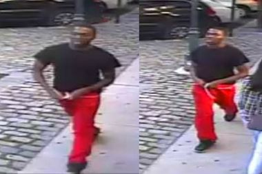 The suspect was last seen wearing a black T-shirt and red sweatpants, police said.