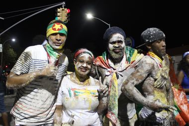 Four friends pose on Empire Boulevard and Rogers Avenue in Crown Heights during the 2016 J'Ouvert parade. Lots of revelers cover themselves in paint, baby power or grease during the celebration, which marks the beginning of the Caribbean holiday of Carnival.