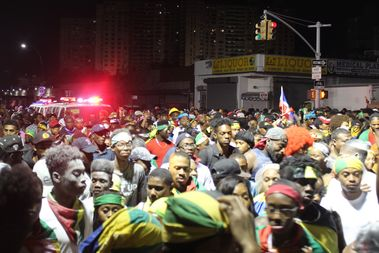 Revelers flood the streets on Empire Boulevard during 2016's J'Ouvert parade.
