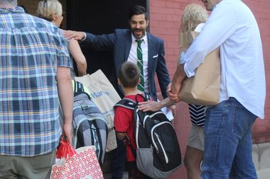 Principal Nate Pietrini greets students walking into Hawthorne Scholastic Academy on the first day of school on Sept. 6, 2016.