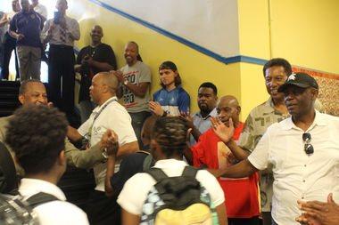 The men greeted the students on their first day back.