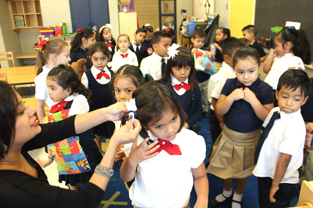 Donning navy uniforms and backpacks filled to the brim with supplies, more than 600 students returned to school at  Orozco Community Academy  Tuesday.