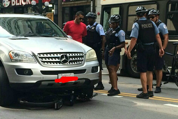This Mercedes SUV hit a bicycle police officer Tuesday afternoon, according to reports.