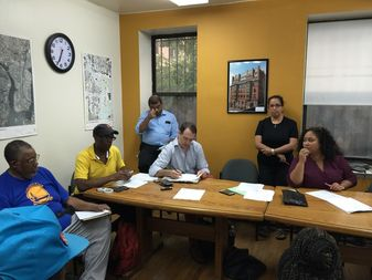 At the community board meeting, the board grilled the agency on its outreach to East Harlem.