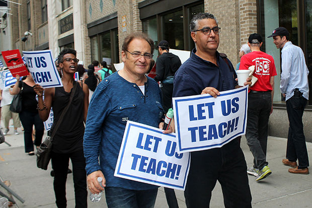 Faculty members protested outside Long island University after they were locked out from the school following the expiration of their union contract with the administration.