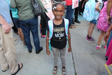 First grader Maalia Noel picked her cat ears to wear for the first day of school at P.S. 198.