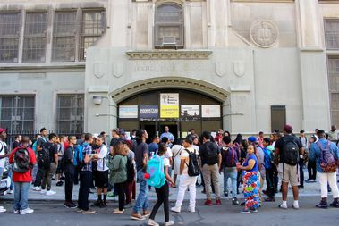 Students gather outside the Bayard Rustin Educational Complex on their first day of school.