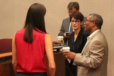 Budget Director Alexandra Holt talks with Ald. Walter Burnett Jr. before the committee meeting.