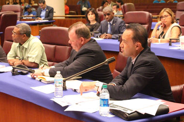 Ald. George Cardenas (right) faced off against Ald. Walter Burnett Jr. (left) over redistributing TIF funds to CPS.