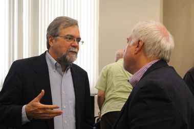 Architecture aficionados Jim Peters and Ward Miller talk after Monday's hearing.