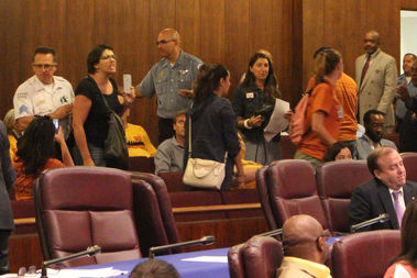 CPS parents are ushered out of the City Council gallery by police while chanting,