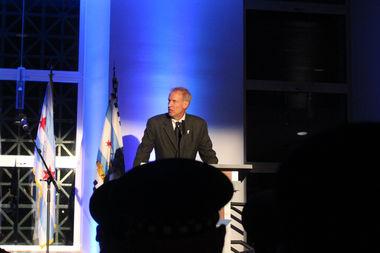 Bruce Rauner speaks at a vigil for fallen Chicago Police officers