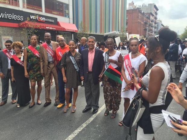 Adrinao Espaillat (center) marched in the African American Day Parade in Harlem. Here he is next to first lady Chirlane McCray.
