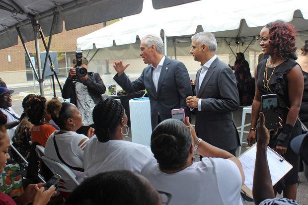 Whole Foods Market-Englewood employees (front row) meet Mayor Rahm Emanuel and London Mayor Sadiq Khan during a visit.