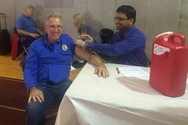 State Sen. John Mulroe, D-Jefferson Park, gets a flu shot.