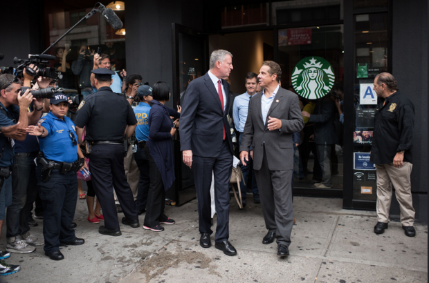Mayor Bill de Blasio has fashioned himself as one of New York's leading progressive politicians, but now de Blasio has competition in the effort to claim the progressive mantle in New York state— his ongoing and bitter rival, Gov. Andrew Cuomo. De Blasio and Gov. Cuomo tour the area affected by the Chelsea bomb explosion in September 2015.