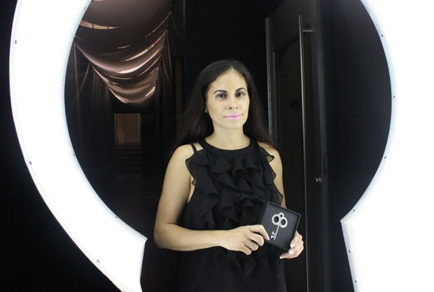 Brenda Ramos, the co-owner and manager of Claustrophobia Escape Room Brooklyn, holds a key given to those who solve the puzzle and escape the simulated environment at the space.