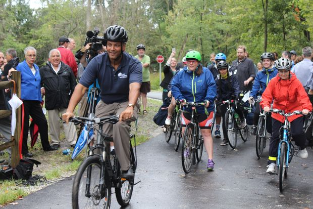 The first phase of the North Branch Trail opened Wednesday, delighting riders despite a persistent rain.