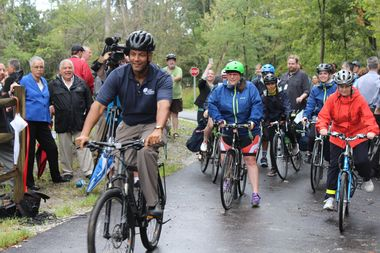 Riders celebrate the opening of the first phase of the North Branch Trail extension in September 2016