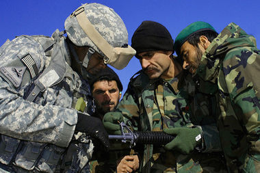 A U.S. Army captain trains local soldiers in Kandahar, Afghanistan in 2008.