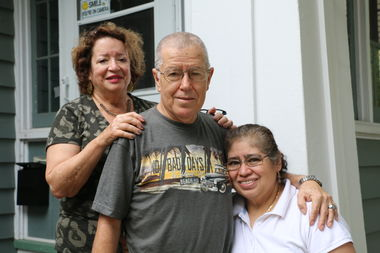 Victor Noriega (center) was nearly killed in a hit-and-rush crash in early July. Since Noriega was unable to return to work while he recovered, Marcia Fishman (left), who lives in the building where Victor worked, helped create a GoFundMe campaign to pay for the family's mortgage and bills.