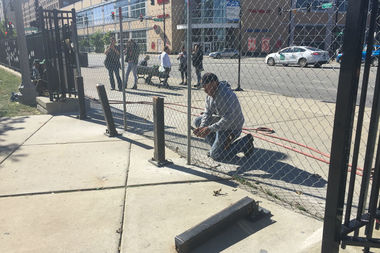 Officials erected a fence around Stewart School, a longtime homeless encampment, Monday morning.