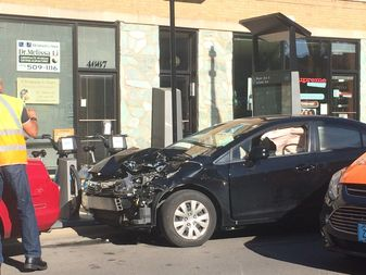 Brown Line trains between Kimball and Southport were temporarily suspended after a train crashed with a vehicle near the Francisco station Monday afternoon, the agency said. The car was photographed just north of the CTA tracks.