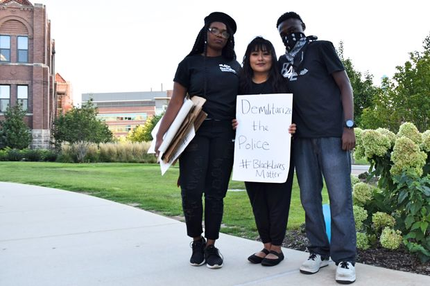Sacora Williams, Cristina Nunez and Kevin Williams outside Loyola University Monday said in their protest they wanted to show solidarity between
