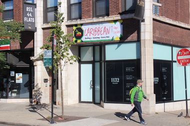A sign for the Jerk Stop has appeared on the FLATS Chicago building at 1312 W. Wilson Ave.