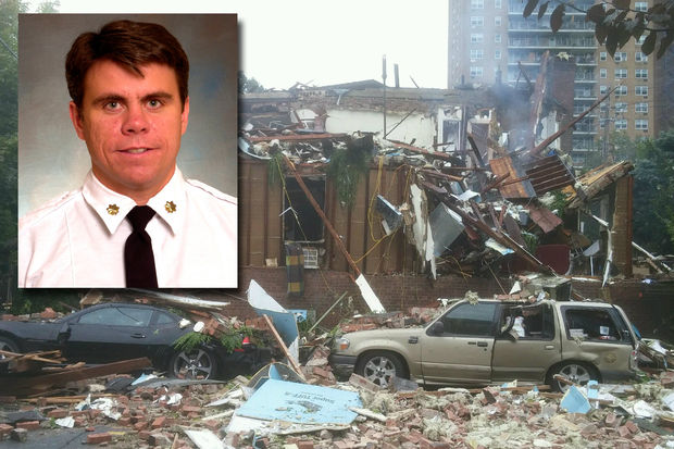 A piece of the roof flew into the street and fatally struck Captain Michael Fahy, officials said.