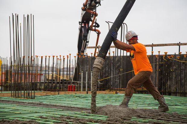 Workers poured 2,800 cubic yards of concrete for the project's waterfront loading dock.