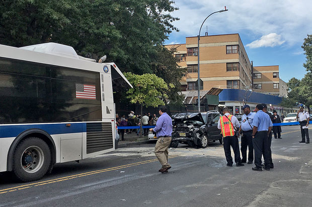 Four people were injured after an SUV rear-ended an MTA bus on Graham Avenue Tuesday, Sept. 27, 2016.