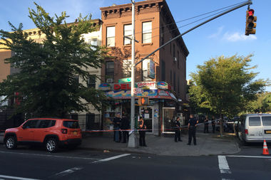 Two people were shot inside a Tompkins Avenue deli, police said.