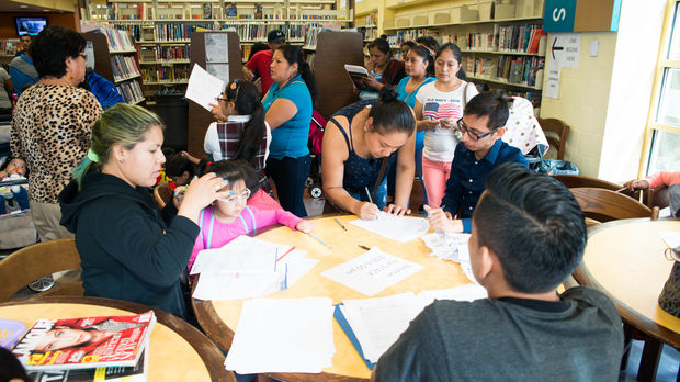 Parents registered their kids for the free after-school program STACKS at the Corona Library on Sept. 27, 2016.