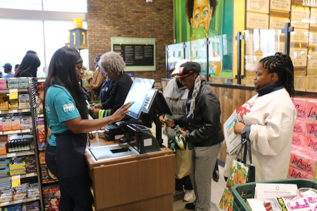 Customers pay for their groceries at a new Whole Foods in Englewood.