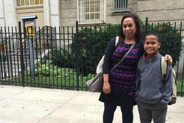 Johanna Garcia, 42, with her son Aries Anderson, 8, in front of P.S. 187 in Washington Heights. Garcia plans to participate in the annual march to Albany to call attention to the Campaign for Fiscal Equity's school funding lawsuit and the money still owed to NYC public schools.