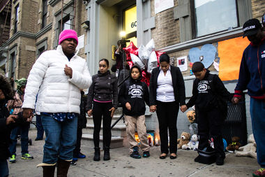 West Harlem residents formed a prayer circle at a vigil for the death of 6-year-old Zymere Perkins
