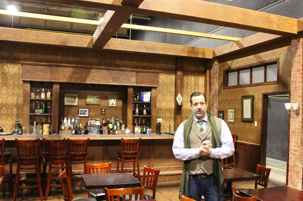 John Corba, director of DePaul's Cinespace Studios, on a bar set that can also be converted to a restaurant and other uses.