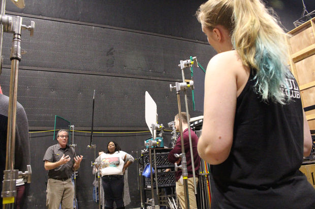 An instructor teaches a cinematography class at DePaul's Cinespace Studios.